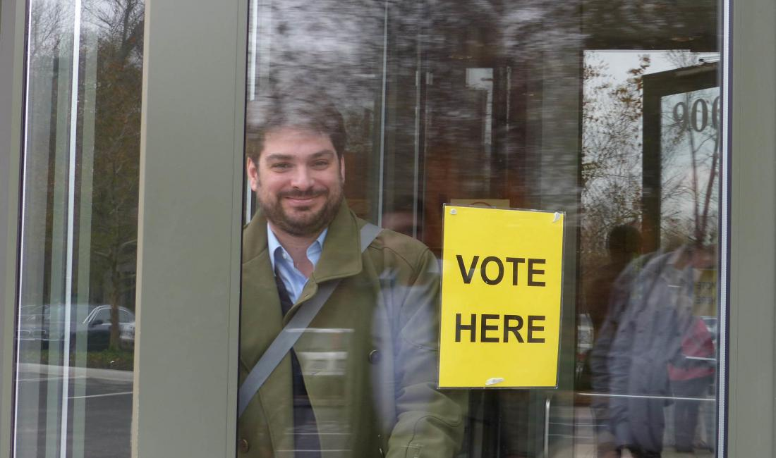 Rafael Pineiro, board member of Democracy International, leaves a polling station in Kansas during the 2014 US midterm elections, with several ballot measures.